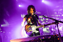 © Licensed to London News Pictures. 08/03/2014. London, UK.   Temples performing live at Shepherds Bush Empire.  In this pic - Adam Smith Temples are an English psychedelic rock band consisting of members James Edward Bagshaw (singer/guitarist), bassist Thomas Edison Warmsley (bass), Sam Toms (drums) and Adam Smith (keyboards/guitar/vocals).   Photo credit : Richard Isaac/LNP