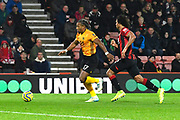 Adama Traore (37) of Wolverhampton Wanderers on the attack chased by Nathan Ake (5) of AFC Bournemouth during the Premier League match between Bournemouth and Wolverhampton Wanderers at the Vitality Stadium, Bournemouth, England on 23 November 2019.