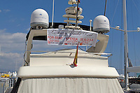Rental signage on luxury cruisers, yachts, etc, at Puerto Banus, Marbella, Spain is now usually in three languages, English and Russian as well as Spanish. March 2015. 201503160604<br /> <br /> Copyright Image from Victor Patterson, 54 Dorchester Park, Belfast, UK, BT9 6RJ<br /> <br /> t: +44 28 9066 1296<br /> m: +44 7802 353836<br /> vm +44 20 8816 7153<br /> <br /> e1: victorpatterson@me.com<br /> e2: victorpatterson@gmail.com<br /> <br /> www.victorpatterson.com<br /> <br /> IMPORTANT: Please see my Terms and Conditions of Use at www.victorpatterson.com