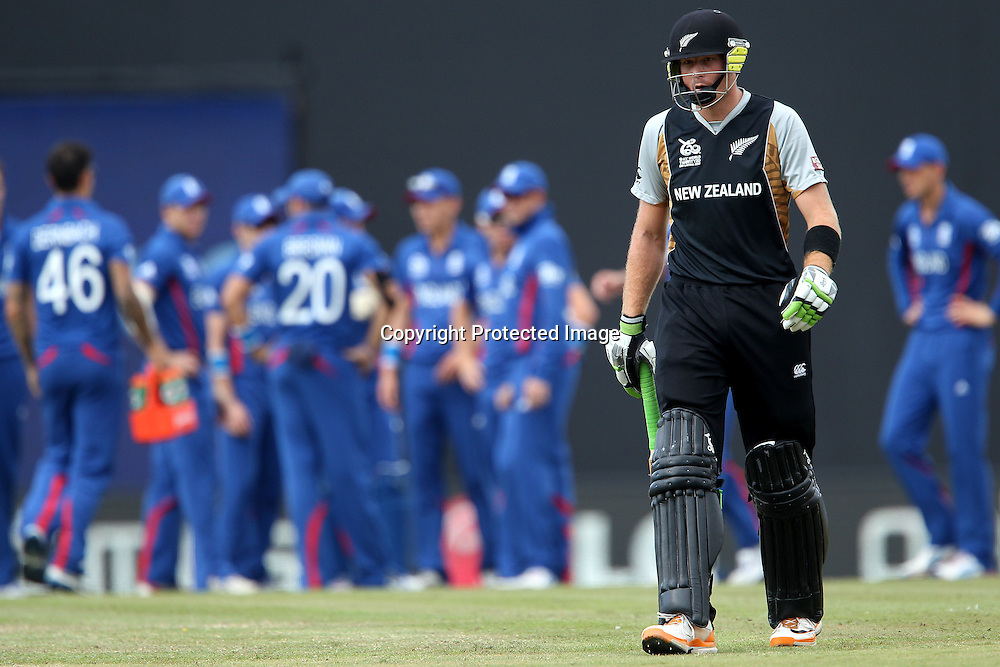 Martin Guptil departs during the ICC World Twenty20 Super 8s match between England and New Zealand held at the  Pallekele Stadium in Kandy, Sri Lanka on the 29th September 2012<br /> <br /> Photo byRon Gaunt/SPORTZPICS/PHOTOSPORT