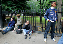 UK ENGLAND LONDON 7JUL05 - Stranded passengers contemplate in shock the news of a series of bomb attacks on the public transport system in central London. At least two people have been killed and scores have been injured after at least seven blasts on the Underground network and a double-decker bus in London...jre/Photo by Jiri Rezac ..© Jiri Rezac 2005..Contact: +44 (0) 7050 110 417.Mobile:  +44 (0) 7801 337 683.Office:  +44 (0) 20 8968 9635..Email:   jiri@jirirezac.com.Web:    www.jirirezac.com..© All images Jiri Rezac 2005 - All rights reserved.