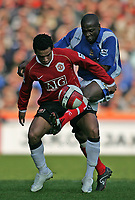 Photo: Lee Earle.<br /> Portsmouth v Manchester United. The Barclays Premiership. 07/04/2007.United's Kieran Richardson (L) battles with Lauren.