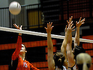 1 Nov. 2011 -- EDWARDSVILLE, Ill. -- Edwardsville High School girls' volleyball player Camrey Saye (13) tips the ball past a host of blockers from Belleville West High School during the IHSA Class 4A girls volleyball sectional semifinal at Edwardsville High School in Edwardsville, Ill. Tuesday, Nov. 1, 2011. Edwardsville won, 2-1. Photo © copyright 2011 Sid Hastings.