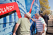 Aug 9, 2010 - SUN CITY WEST, AZ: People sign the Spending Revolt Bus in Sun City West, AZ, Monday. The Spending Revolt Bus stopped in Sun City West, a retirement community northwest of Phoenix, Monday. Spending Revolt is a new coalition of taxpayers and business owners concerned about government spending. The bus is attracting Republican and Tea Party affiliated candidates to its events. The bus has crisscrossed Nevada, California and Arizona and is heading east to Washington DC.   Photo by Jack Kurtz / ZUMA Press