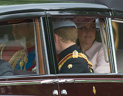 LONDON - UK - 15 JUNE 2013: Princes WIlliam and Harry with Kate arrive at the Palace. <br /> Members of the British Royal Family join HM Queen Elizabeth for the annual Trooping The Colour Ceremony to mark the Queen's Official Birthday. The Queen and members of the family travelled by carriage to Horseguards for the ceremonial parade before joining her on the balcony of Buckingham Palace.<br /> The Duke of Edinburgh who normally accompanies the Queen was absent as he is still in hospital recovering from an operation.<br /> Photograph by Ian Jones.