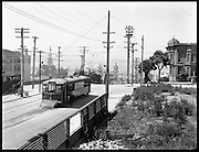 Transportation Was Intrinsic to the A Successful Fair; Competing Transit Agencies Vied to Carry Fair-Goers<br /> <br /> In 1914, San Francisco was an odd patchwork transit options, including a private streetcar company in competition with SF's Municipal Railway. Here, a sparkling new streetcar is posed for a strategic photograph before the still-under-construction exposition—a shot likely taken for publicity to highlight streetcar access to the event.<br /> <br /> John Henry Mentz, Photographer for the United Railroads Company<br /> August 3, 1914