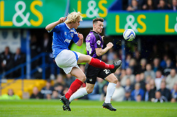 Jack Whatmough (ENG) of Portsmouth clears past Ollie Clarke (ENG) of Bristol Rovers - Photo mandatory by-line: Rogan Thomson/JMP - 07966 386802 - 19/04/2014 - SPORT - FOOTBALL - Fratton Park, Portsmouth - Portsmouth FC v Bristol Rovers - Sky Bet Football League 2.