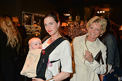 Left to right, FLORA RYCROFT, her daughter LYDIA RYCROFT and SUE JONES at a party to celebrate the publication of Flourish by Willow Crossley held at OKA, 155-167 Fulham Rd, London on 4th October 2016.