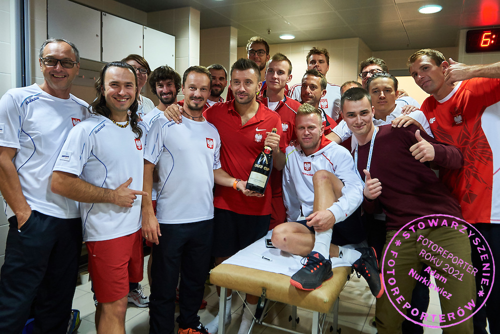 (L-R) Ivan Mochytka and NN and Iwona Pilchowska and Radoslaw Szymanik - captain national team and pshychologist Pawel Habrat and Michal Przysiezny and Kamil Gajewski and Marcin Matkowski and Grzegorz Panfil and trainer assistant Aleksander Charpantidis and Jaroslaw Duda and Tomasz Tolstyko and doctor Hubert Krzysztofiak and Pawel Jakubowski and Lukasz Kubot during Davis Cup Tie World Group Play-off Poland v Slovakia at Gdynia Arena Hall in Gdynia, Poland.<br /> <br /> Poland, Gdynia, September 20, 2015<br /> <br /> Picture also available in RAW (NEF) or TIFF format on special request.<br /> <br /> For editorial use only. Any commercial or promotional use requires permission.<br /> <br /> Adam Nurkiewicz declares that he has no rights to the image of people at the photographs of his authorship.<br /> <br /> Mandatory credit:<br /> Photo by &copy; Adam Nurkiewicz / Mediasport