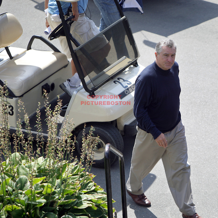 "(09/02/08-Lynn,MA) Robert Deniro quits ""Edge of Darkness"" film Just hours before he quit, De Niro is seen at the Gannon Country Club. According to the local newspaper, the Daily Item of Lynn, observers at the course say the Oscar winner became aggravated after he couldn't lift a shot out a sandtrap dug at least four feet deeper than usual. Director Martin Campbell wanted to fit the actor, the sand trap and the Boston skyline in the shot so he ordered the grounds crew to excavate the pit even deeper. De Niro, who had admitted that he's never played golf before, WALKED OFF THE SET after a reported 20 takes with a swinging sand wedge."