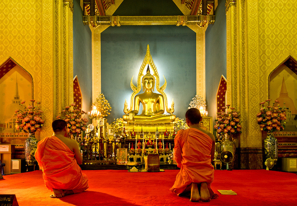 The prayer is performed through out the day, here in the Marble temple, Bangkok Thailand.