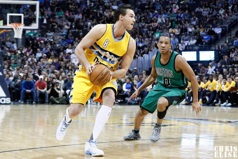10 March 2017: Denver Nuggets forward Danilo Gallinari (8) drives past Boston Celtics guard Avery Bradley (0) during the Denver Nuggets 119-99 victory over the Boston Celtics, at the Pepsi Center, Denver, Colorado, USA.