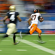 Justice Hill runs the ball during the Alamo Bowl college football game between Oklahoma State and Colorado at the Alamo Dome in San Antonio, Texas, Thursday, December 29, 2016. Kurt Steiss/O'Colly
