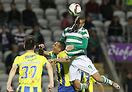 Sporting's forward Slimani heads the ball  during the Portuguese first league football match União vs Sporting held at Madeira stadium in Funchal on December 20, 2015.  LUSA / GREGORIO CUNHA
