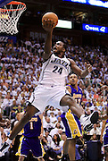 Utah Jazz forward Paul Millsap scores against the Los Angeles Lakers during the first half of Game 3 of the NBA Western Conference second-round playoff series in Salt Lake City, Saturday, May 8, 2010. (AP Photo/Colin E Braley)