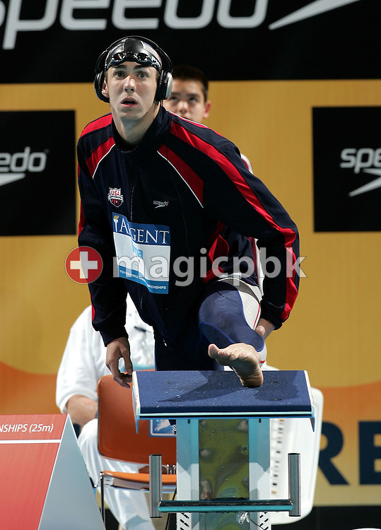 Michael Phelps of the United States stretches before his start in the final of the Men's 200m freestyle in the Swimming Short Course World Championships at Conseco Fieldhouse in Indianapolis, Indiana, Thursday 07 October 2004. (Photo by Patrick B. Kraemer / MAGICPBK)