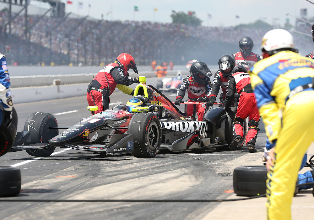 Sebastian Bourdais has pit stop trouble during the 100th running of the Indianapolis 500 May 29, 2016.