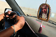A taxi driver and religious talisman, Peru