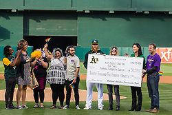 OAKLAND, CA - JUNE 14:  Sean Doolittle #62 of the Oakland Athletics, his girlfriend Eireann Dolan, and University of San Francisco Women's basketball coach Jennifer Azzi present a check to members of the Rainbow Community Center on Pride Night before the game against the Texas Rangers at the Oakland Coliseum on June 14, 2016 in Oakland, California. (Photo by Jason O. Watson/Getty Images) *** Local Caption *** Sean Doolittle; Eireann Dolan; Jennifer Azzi