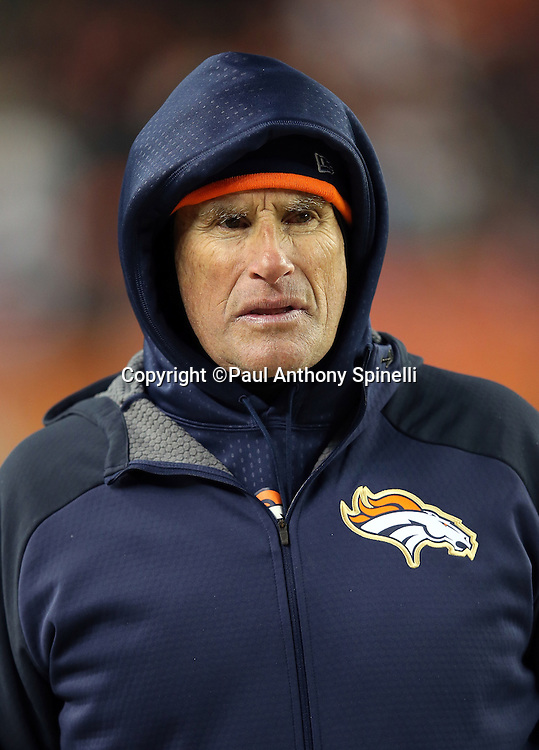 Denver Broncos offensive coordinator Rick Dennison looks on from the sideline while wearing a hoodie during the 2015 NFL week 16 regular season football game against the Cincinnati Bengals on Monday, Dec. 28, 2015 in Denver. The Broncos won the game in overtime 20-17. (©Paul Anthony Spinelli)
