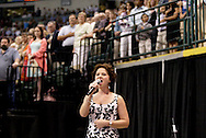 Senior Vocal Performance Major in Music Lauren E. Davis leads the Star-Spangled Banner during Wright State University's 43rd Semiannual Commencement at the Nutter Center, Saturday, June 12, 2010.