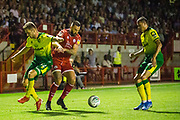 Dennis Srbeny (Norwich) & Ollie Palmer (Crawley Town)  during the EFL Cup match between Crawley Town and Norwich City at The People's Pension Stadium, Crawley, England on 27 August 2019.