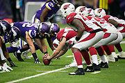 The Arizona Cardinals offensive line gets set to snap the ball at the line of scrimmage opposite the Minnesota Vikings defensive line during the NFL week 6 regular season football game against the Minnesota Vikings on Sunday, Oct. 14, 2018 in Minneapolis. The Vikings won the game 27-17. (©Paul Anthony Spinelli)