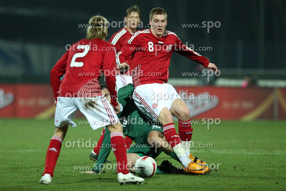 Anton Zlogar (16) of Slovenia faulted by Nicklas Bendtner (8), in front Christian Poulsen (2), a the back Jon Dahl Tomasson during the UEFA Friendly match between national teams of Slovenia and Denmark at the Stadium on February 6, 2008 in Nova Gorica, Slovenia.  Slovenia lost 2:1. (Photo by Vid Ponikvar / Sportal Images).