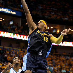 25 April 2009: Denver Nuggets forward Carmelo Anthony (15) drives past New Orleans Hornets forward David West (30) during a 95-93 win by the New Orleans Hornets over the Denver Nuggets in game three of the NBA Western Conference quarter-finals playoff at the New Orleans Arena in New Orleans, Louisiana.