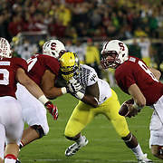 Punahou alumnus, Deforest Buckner, was double teamed most of the evening during his intense struggle with the Stanford Offense.  The Stanford Cardinals upset the Oregon Ducks 26-20 at Stanford Stadium.  11/7/13, 3:30pm, Photo by Barry Markowitz