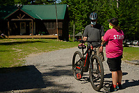 Sara Caveney offers instruction to reporter Rick Green prior to joining an EBike Tour on the trails at Gunstock on Tuesday morning.  (Karen Bobotas/for the Laconia Daily Sun)