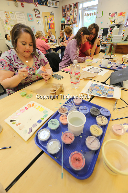 Allana Austin, from left, Kim Fandel and Carolyn Beasley take their time on their pottery during their printing and pottery for everybody class as part of the Tupelo Public School District May Institute on Tuesday.