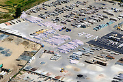 Nederland, Limburg, Gemeente  Echt-Susteren, 26-06-2014; terrein met opslag van zand, natuursteen, tegels en andere bouwmaterialen.<br /> Yard and storage area with sand, stone, tiles and other building materials.<br /> luchtfoto (toeslag op standaard tarieven);<br /> aerial photo (additional fee required);<br /> copyright foto/photo Siebe Swart.