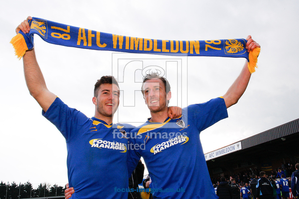 Picture by Andrew Tobin/Focus Images Ltd +44 7710 761829.27/04/2013. Jonathan Meades of AFC Wimbledon (L) and Jack Midson of AFC Wimbledon celebrate staying up after winning 2-1 during the npower League 2 match at the Cherry Red Records Stadium, Kingston.