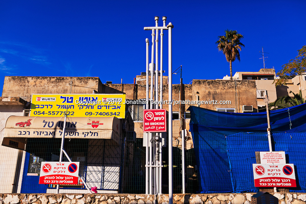 Vent pipes and signs on the edge of a gas station parking area in Hod Hasharon, Israel. WATERMARKS WILL NOT APPEAR ON PRINTS OR LICENSED IMAGES.