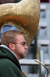 18 October 2014:  Well used tuba being carried by tuba player during an NCAA division 3 football game between the Augustana Vikings and the Illinois Wesleyan Titans in Tucci Stadium on Wilder Field, Bloomington IL