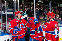KELOWNA, CANADA - MARCH 3:  Tyson Helgesen #6 fist bumps teammates to celebrate the win against the Kelowna Rockets on March 3, 2018 at Prospera Place in Kelowna, British Columbia, Canada.  (Photo by Marissa Baecker/Shoot the Breeze)  *** Local Caption ***