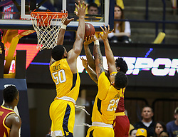 Feb 24, 2018; Morgantown, WV, USA; West Virginia Mountaineers forward Sagaba Konate (50) blocks a shot by Iowa State Cyclones forward Zoran Talley Jr. (23) during the second half at WVU Coliseum. Mandatory Credit: Ben Queen-USA TODAY Sports