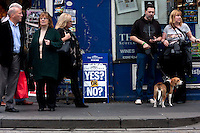 Members of the public stand on the street next to the Newspaper advertiser about Yes or No?<br /> Members of different political ideal gather in the scottish parliament due what Today 18th September is the Scottish Referendum. Pako Mera/Universal News And Sport (Europe) 18/09/2014