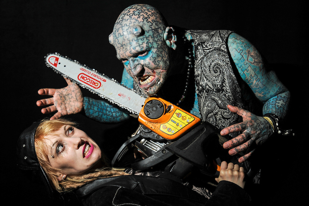 Heavily tattooed Enigma and chainsaw-wielding Serana Rose are pictured at the Copenhagen Ink Festival 2013.