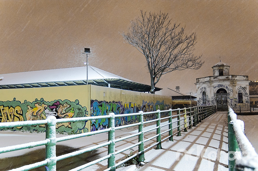 Night snowfall over the buildings of the former slaughterhouse in Testaccio, Rome