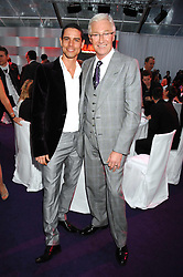 Left to right, ANDRE PORTASIO and PAUL O'GRADY at the 2008 Glamour Women of the Year Awards 2008 held in the Berkeley Square Gardens, London on 3rd June 2008.<br />