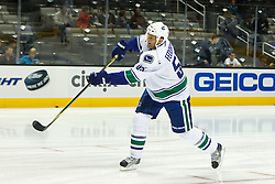 Sep 29, 2011; San Jose, CA, USA; Vancouver Canucks left wing Todd Fedoruk (55) warms up before the game against the San Jose Sharks at HP Pavilion.  San Jose defeated Vancouver 3-0. Mandatory Credit: Jason O. Watson-US PRESSWIRE