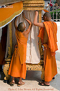 Buddhist monks are preparing an altar to pay tribute to the holy Pra Bang Buddha at Wat Sawannaphumaham in Luang Prabang Laos. Luang Prabang is a UNESCO World Heritage City.