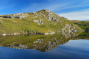 Coastline reflected in a pool<br /> Isle Aux Morts<br /> Newfoundland & Labrador<br /> Canada