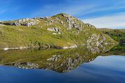 Coastline reflected in a pool<br /> Isle Aux Morts<br /> Newfoundland & Labrador<br /> Canada