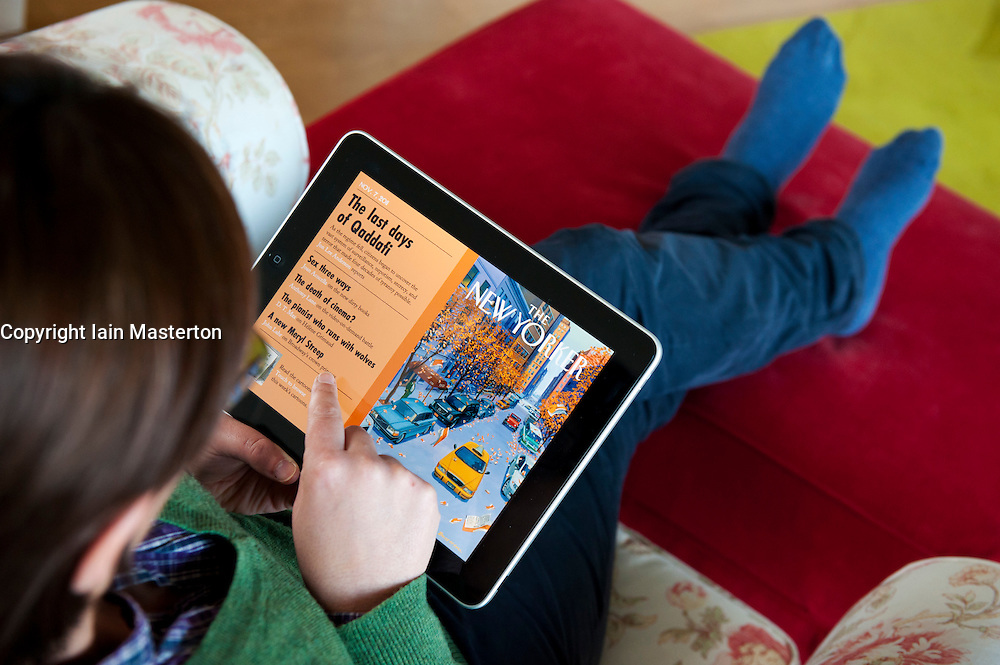Woman using iPad tablet computer to read The New Yorker magazine online