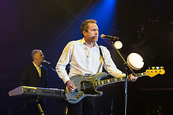 © Licensed to London News Pictures . 09/08/2015 . Siddington , UK . ANDY MCCLUSKEY (r) and PAUL HUMPHREYS of OMD ( Orchestral Manoeuvres in the Dark ) performing . The Rewind Festival of 1980s music , fashion and culture at Capesthorne Hall in Macclesfield . Photo credit: Joel Goodman/LNP