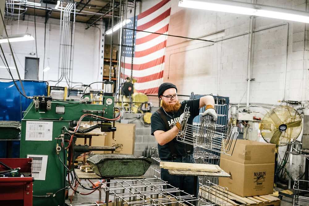 Jason Ducote works on Dolby 3D glass holders at Marlin Steel Wire Products LLC in Baltimore on March 16, 2017. Marlin Steel uses three robots on their production floor, one from Ready Robotics, a company less than two miles away. CREDIT: Greg Kahn / GRAIN for the Wall Street Journal ROBOTGAP