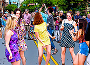 Go-go dancers in the street dancing to the music of British Invasion cover band The GB's at the May 2018 DADA Gallery Hop in Winston-Salem, North Carolina.